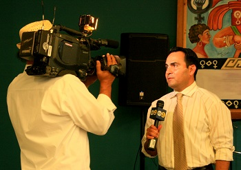 Oscas de la Torre speaks on camera at the Pico Youth & Family Center